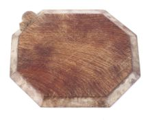 A Robert 'Mouseman' Thompson oak octagonal bread board, with moulded corners,