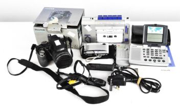 A Fujifilm s4400 digital camera together with a Philips compact cassette player and other items