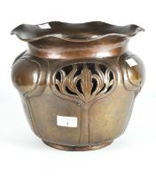 An early 20th century Art Nouveau copper jardiniere, adorned with pierced and embossed detailing,