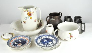 A ceramic toilet set, comprising a jug, wash bowl, vase, lidded pot and bedpan, and other items