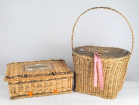 Two wicker baskets, both with lids and handles to the top,