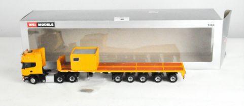 A WSI Model model No. 04-1180 WSI Yellow Line Scania Streamline Topline 6x4 with Ballast Trailer