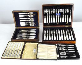 A set of silver fish forks together with three boxes of plated cutlery, and a canteen