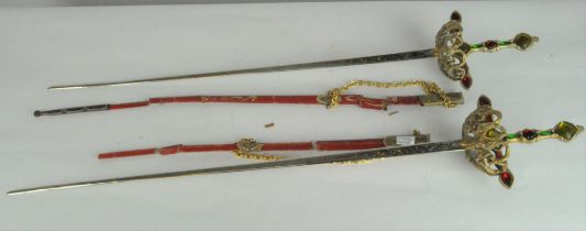 Two reproduction dress swords, each with jewelled metal handle,