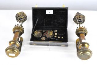 A pair of GNR glass and brass railway lamps together with a cased set of weighing scales