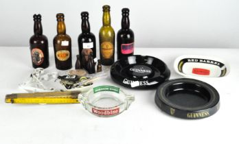 Five Guinness glass bottles with original labels, together with two ashtrays, and more