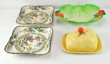 A pair of Royal Doulton plates with a Beswick 'lettuce and tomato' dish and a Devon cheese dish