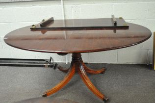 A mahogany oval table with leaf, raised
