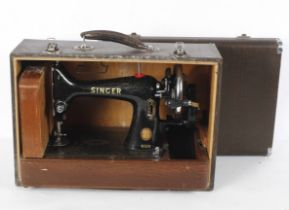 A Singer 99k hand cranked sewing machine