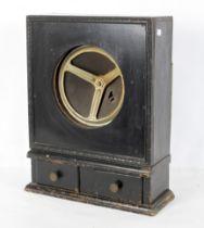 A vintage speaker in a wooden cabinet wi