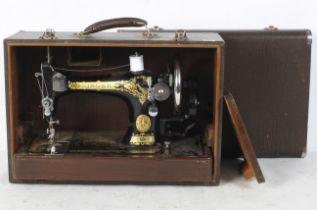 A Singer 128 hand crank sewing machine,
