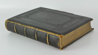 A late 19th century black and white photo album, containing mostly period portrait scenes,