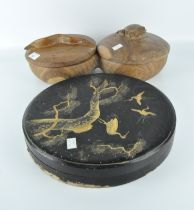 A Japanese black lacquer circular box, decorated with cranes between pine tree branches,