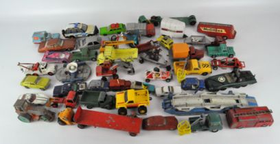 A collection of play worn Diecast vehicles, including examples by Corgi,