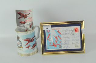 A signed Red Arrows postcard, framed; ,