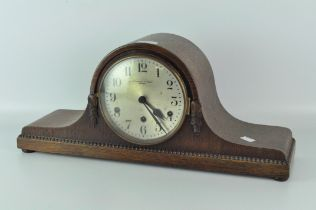 An early 20th century mantel clock, silvered dial with Arabic numerals, signed 'Pleasance & Harper,