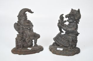 A pair of cast metal Punch and Judy door stops,