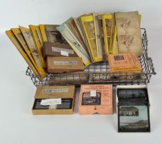 A collection of boxed sets of magic lantern slides stereo view photographs and Stereoscopic glass