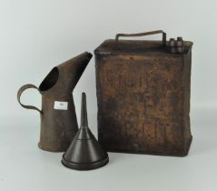 An early metal petrol can together with metal oil jug and funnel