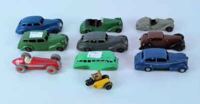 Eleven post war Dinky Diecast vehicles, including a green Alvis, blue Oldsmobile,