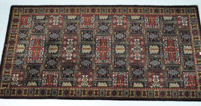 A 20th century floor rug, geometric patterns,