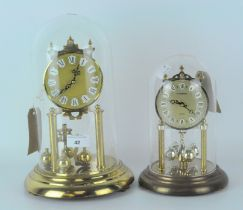 Two contemporary skeleton clocks, metal dials with Roman numerals and gilt frames