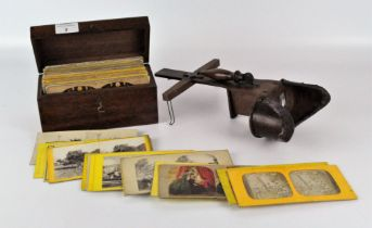 85 antique Stereoview photographs in card frames, placed in a period wooden storage box,