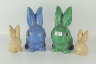 A group of four Sylvac rabbits, including a large blue rabbit, 1028,