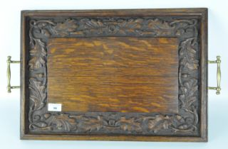 A late 19th/early 20th century oak serving tray, of rectangular form,