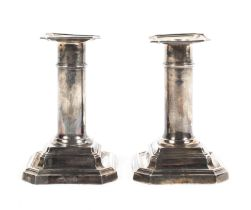 A pair of small sterling silver candlesticks with loaded bases by James Dixon & Sons Ltd Sheffield.