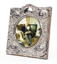 A sterling silver picture frame with raised decoration. by Ray Hall Sheffield 1990. 15cm x 15cm.