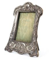 A sterling silver picture frame with Art nouveau style decoration by Samuel M Levy Birmingham 1910
