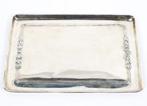 A sterling silver rectangular card tray with raised floral border, Sheffield 1985 26cm x 17.5cm.