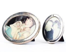 Two oval sterling silver desk top picture frames, 11cm x 9cm 17cm x 13cm.