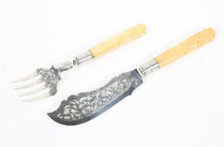 A pair of silver fish servers.