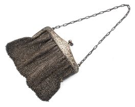A ladies sterling silver evening bag with silver clasp with chased and engraved decoration and