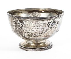 A sterling silver circular footed bowl with swags and garland decoration by Elkington & Co.