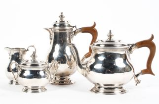 A four piece sterling silver tea set of bulbous form on circular stepped foot.