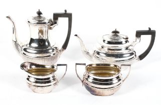 An Edwardian four piece EPNS tea service, in the Georgian style, of reeded form, 20.