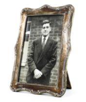 A sterling silver desk top photo frame. 16cm x 11cm.