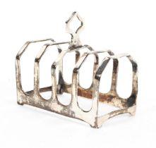A sterling silver four slice toast rack by Edward Viner Sheffield 1936. 1.72ozt.