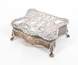 A small sterling silver jewellery casket on four ball and claw feet with velvet lined interior, 7.