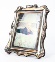 A sterling silver picture frame by Roberts and Briggs. Sheffield,1990. 25cm x 19cm.