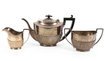 A three piece sterling silver tea set with half fluted design and ebonised handle and knop by