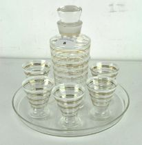 An Art Deco glass cocktail serving set with six matching glasses and tray,