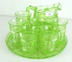 A six piece Uranium green glass lemonade set