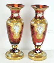 A pair of large cranberry glass vases,