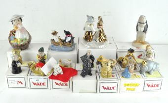 A collection of twenty Wade ceramic figures, various designs and models,