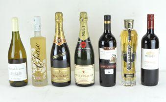 Seven vintage bottles of alcohol, including a bottle of Moet & Chandon premiere cuvee,