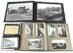 A collection of 20th century photographs and postcards, spread over three albums,